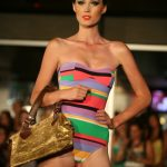Swimwear fashions with coral lips, smokey eyes and slick hair by Adelaide mobile hair and makeup artist Make-Overs Australia
