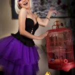 Purple makeup with feather lashes by Adelaide mobile hair and makeup artist Make-Overs Australia